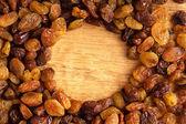Diet healthy food. Border of raisin on wooden background — Stock Photo