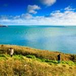 Irish landscape. coastline atlantic coast County Cork, Ireland. Woman walking — Stock Photo
