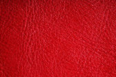 Red textured leather grunge background closeup — Stock Photo