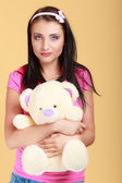 Childish young woman,  infantile girl in pink hugging teddy bear toy — Stock Photo