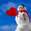 Little happy christmas snowman red heart love symbol outdoor. Winter. — Stock Photo #45547591