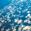 Sky. View from window of airplane flying in clouds — Stock Photo #45753105