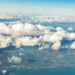 Sky. View from window of airplane flying in clouds — Stock Photo #45753107