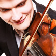 Man violinist playing violin. Classical music art — Stock Photo #45796985