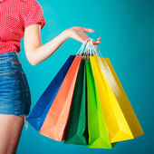 Colorful shopping bags in female hand. Sale retail — Stock Photo