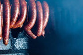 Smoked sausuages in smokehouse. — Zdjęcie stockowe
