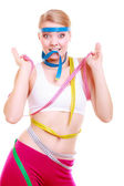 Obsessed fitness woman with a lot of colorful measure tapes — Stock Photo