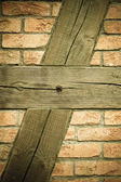 Brick wall with wooden beams background — Stock Photo