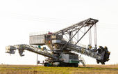 Opencast brown coal mine. Bucket wheel excavator. — Stock Photo