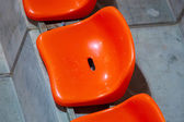 Closeup of red sport stadium seats. Empty stand. Team sport supporter — Stock Photo