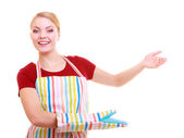 Housewife or waitress making inviting welcome gesture kitchen apron isolated — Stock Photo