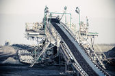 Opencast brown coal mine. Belt conveyor. — Stock Photo