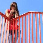 Trendy cool teenage girl on the urban bridge — Stock Photo #46369191