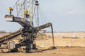 Opencast brown coal mine. Giant excavator. — Stock Photo