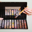 Colorful eyeshadows palette with makeup brush — Stock Photo #46571119