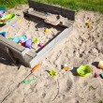 Childhood. Sandpit sandbox with toys on playground. — Stock Photo #46571297