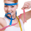 Sporty fit woman with measure tapes. — Stock Photo