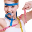 Sporty fit woman with measure tapes. — Stock Photo #46571443