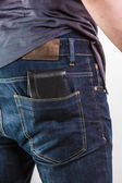 Careless man with wallet on back pocket. Theft. — Stock Photo
