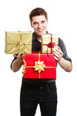 Young man giving presents gifts boxes — Stock Photo