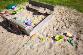 Childhood. Sandpit sandbox with toys on playground. — Stock Photo