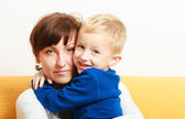 Happy family. Boy hugging mother expressing feelings. — Stock Photo