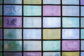 Colored stained glass window with regular block pattern blue green tone — Stock Photo
