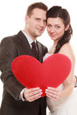 Bride and groom holding heart love — Stock Photo