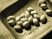 Pistachios nuts in wooden bowl. Unhealthy food. — Zdjęcie stockowe