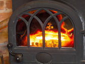 Closeup fireplace with fire interior. Heating. — 图库照片