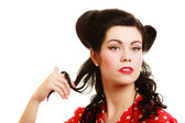 Coquette pinup girl playing with hair — Stock Photo