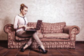 Business woman using computer. Internet home technology. Vintage photo. — Stock Photo
