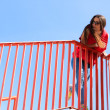 Trendy cool teenage girl on the urban bridge — Stock Photo #47586665