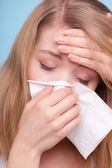 Sick girl sneezing in tissue. Health — Stock Photo