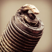 Old spark plug as spare part of car. — Stock Photo