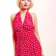 Portrait beautiful pinup girl in blond wig retro red dress — Stock Photo #47913281