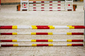 Yellow red white obstacle for jumping horses — Stock Photo