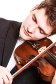 Man violinist playing violin — Stock Photo