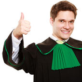 Man lawyer in polish gown showing thumb up — Stock Photo