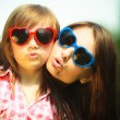 Mother and kid in sunglasses making funny faces — Stock Photo #48437617