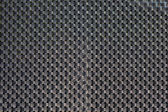 Black plastic weave as woven background texture — Stock Photo