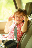 Transportation. Little girl child kid sitting in the car — Foto Stock