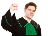Man lawyer in polish gown counting on fingers — Stock Photo