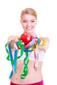 Fitness woman  holding colorful measure tapes fruit — Stock Photo