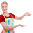 Housewife or waitress making inviting welcome gesture kitchen apron — Stock Photo #48747423