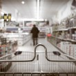 View from shopping cart trolley at supermarket shop — Stock Photo #48747465