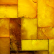 Closeup of golden amber mosaic as background or texture — Stock Photo #48747471