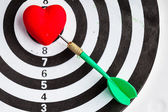 Black white target with dart in heart love symbol as bullseye — Stock fotografie