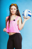 Fashion teen girl listen music mp3 and holding a ball — Stock Photo