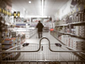 View from shopping cart trolley at supermarket shop — Stockfoto